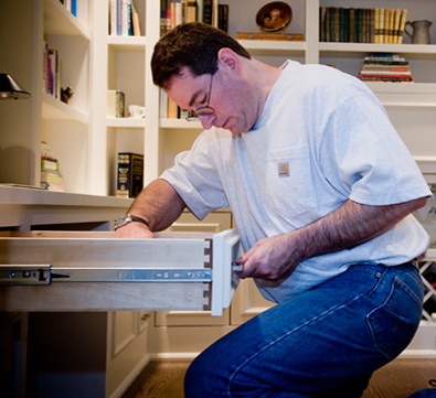 Mike works on custom cabinets